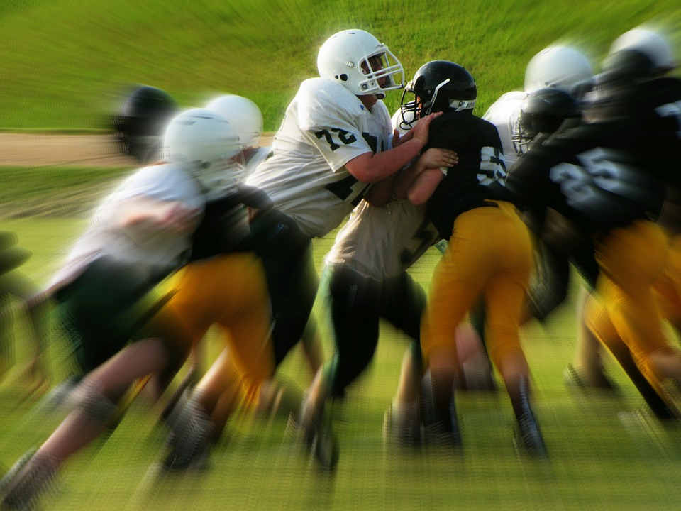 American Football Blurred Image two teams pushing against each other