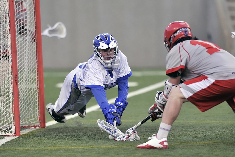 2 Lacrosse players on different teams going for the ball in Ohio
