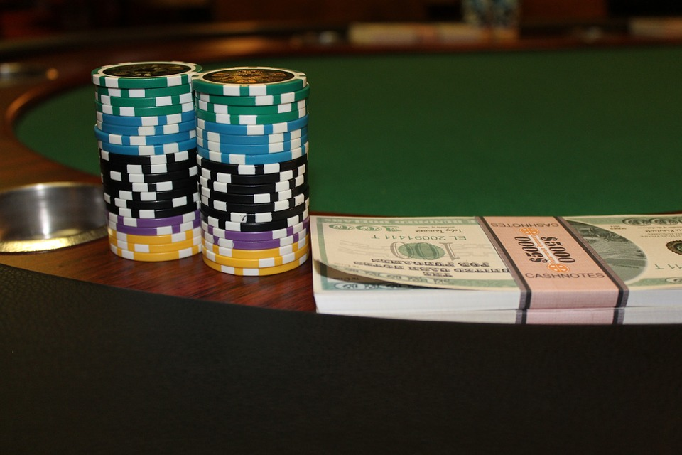2 Piles of poker chips and a stack of money