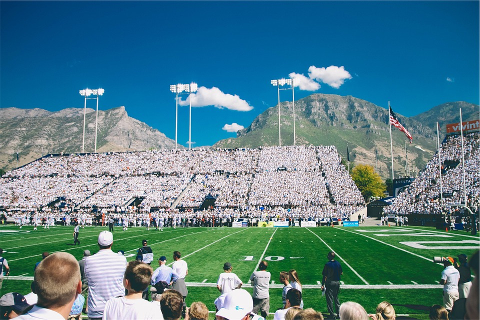 american football stadium with crowd and mountain backdrop