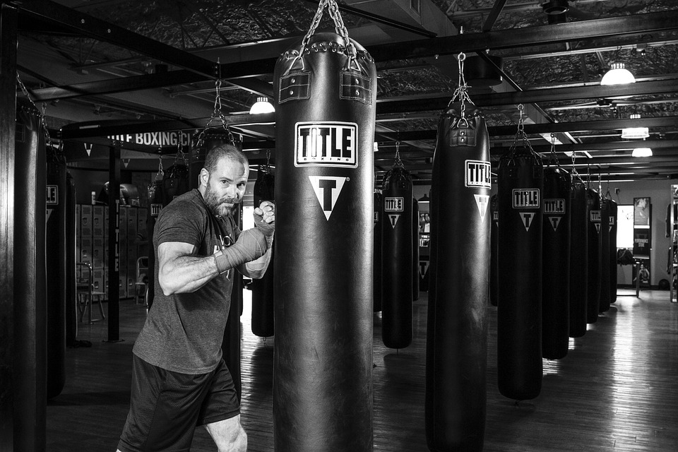 man about to punch a punch bag, black & white image