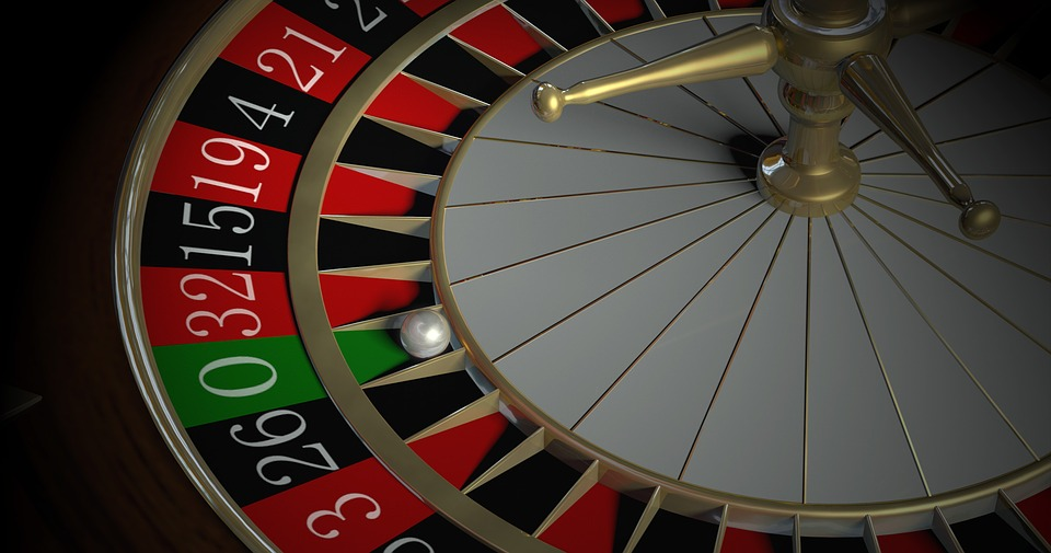 roulette wheel with the ball on the green 0